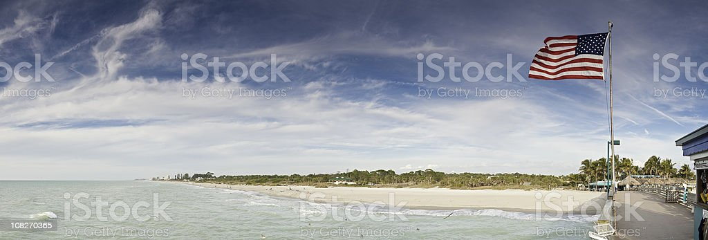Patriotic pier panorama Gulf Coast ocean beach Florida USA stock photo
