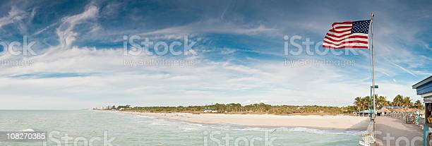 Patriotic pier panorama Gulf Coast ocean beach Florida USA