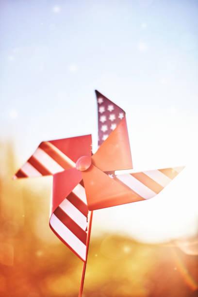 Patriotic pinwheel spinning in summer sunshine stock photo
