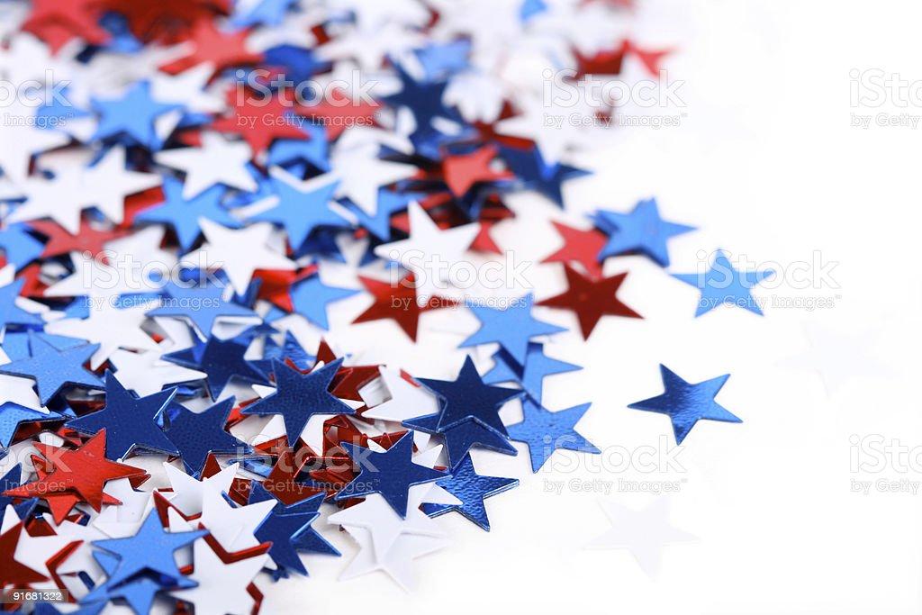Patriotic red, white and blue star confetti stock photo