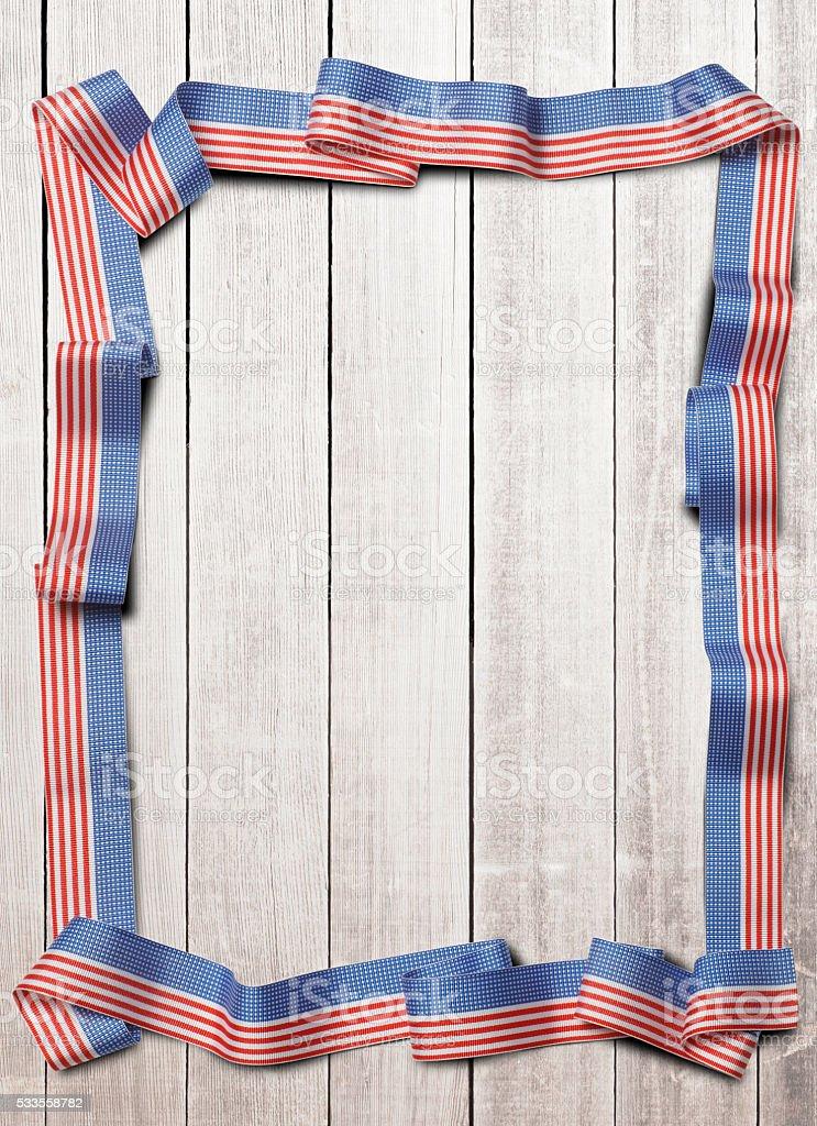 Patriotic Ribbon On Whitewashed Wooden Planks stock photo