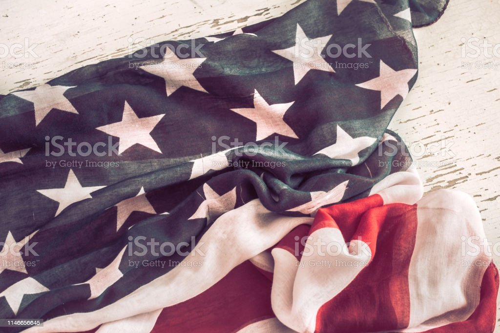 National Patriotic symbols. American flag on old white wooden...