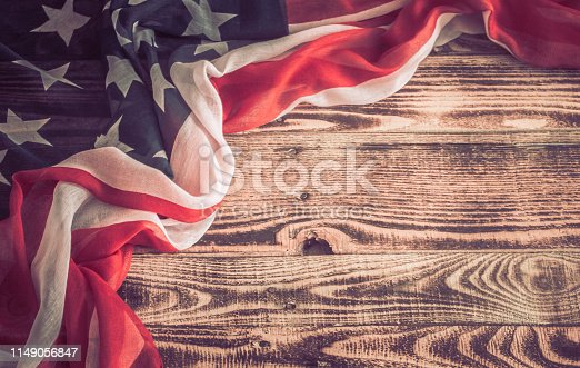 istock Patriotic symbols. American flag on an old wooden background. 1149056847