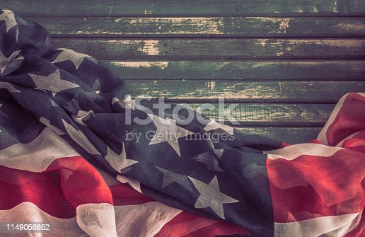 istock Patriotic symbols. American flag on an old wooden background. 1149056852