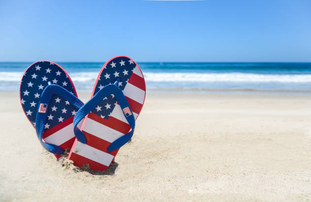 patriotic usa background on the sandy beach - july stock photos and pictures