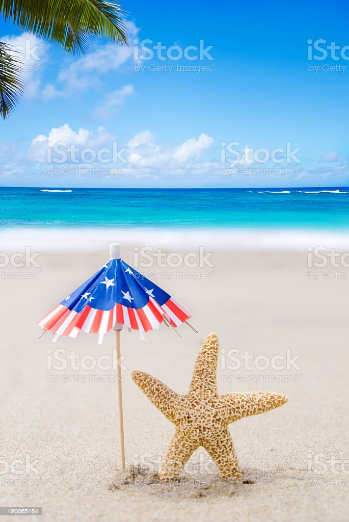 Patriotic USA background with starfishes and decorations on the sandy...