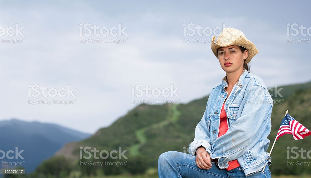 Patriotic woman in the American West stock photo