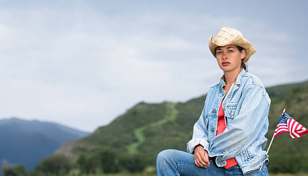 patriotic woman in the american west - kellyjhall stock pictures, royalty-free photos & images