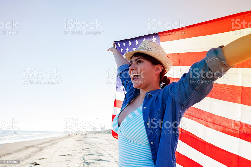 Patriotic woman on the beach stock photo