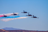 Miramar, USA - October 4, 2014: Miramar, California, USA- October 4, 2014 The US Navy Flight Demonstration Squadron showing precision flying with their Boeing F/A-16 US NAVY Patriots Squadron aircraft at the 2014 Miramar airshow in California. On this hot day the were many aircraft representing each military branch and displaying their aviation force.