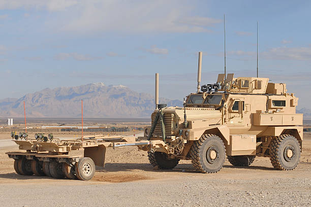 IED Patrol Afghanistan The MAXPRO version of the MRAP with the sparks mine roller attached in the desert of Afghanistan. Afghanistan stock pictures, royalty-free photos & images