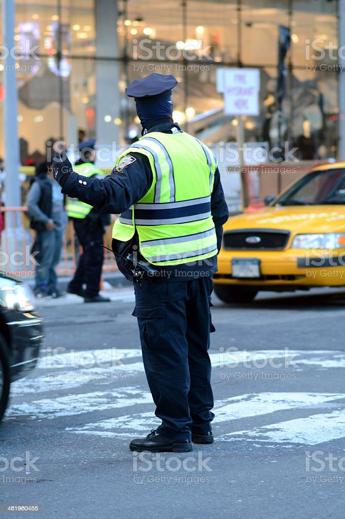 Patrolman guiding cars through traffic in the city stock photo