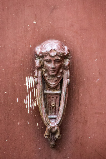 patron goddess of the house, artistic knocker of the ancient door
