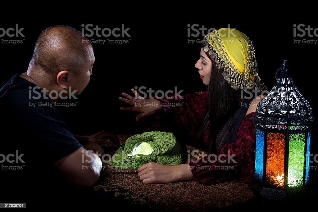 Patron Pawning Ring to Gypsy Con Artist stock photo