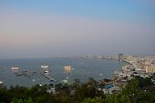 Sitting in the Gulf of Thailand, Pattaya is a tourist Mecca as well as an ex-pat residence for many nationalities, notably US Vietnam veterans. At twilight, this view is from Pattaya Vantage Point south of the main city.