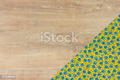 873286578 istock photo Pattern flower cloth napkin on empty wooden background. 873286556