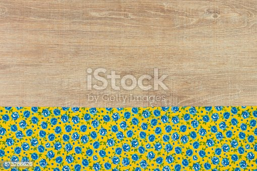 873286578 istock photo Pattern flower cloth napkin on empty wooden background. 873286626