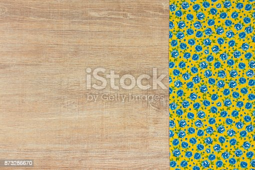 873286578 istock photo Pattern flower cloth napkin on empty wooden background. 873286670