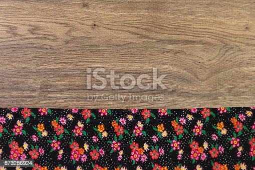 873286578 istock photo Pattern flower cloth napkin on empty wooden background. 873286924