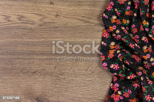 873286578 istock photo Pattern flower cloth napkin on empty wooden background. 873287168