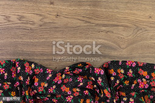 873286578 istock photo Pattern flower cloth napkin on empty wooden background. 873287170