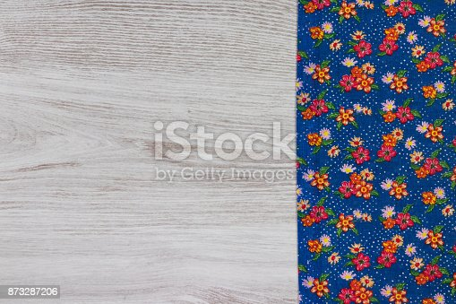 873286578 istock photo Pattern flower cloth napkin on empty wooden background. 873287206