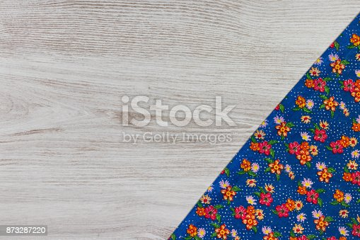 873286578 istock photo Pattern flower cloth napkin on empty wooden background. 873287220