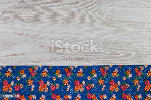 873286578 istock photo Pattern flower cloth napkin on empty wooden background. 873287228