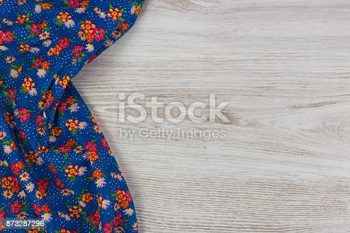 873286578 istock photo Pattern flower cloth napkin on empty wooden background. 873287296