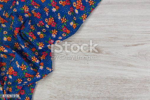 873286578 istock photo Pattern flower cloth napkin on empty wooden background. 873287318