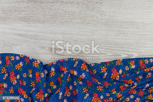 873286578 istock photo Pattern flower cloth napkin on empty wooden background. 873289340