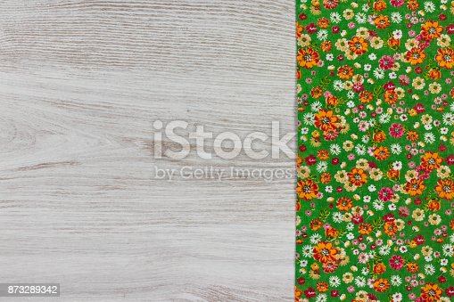 873286578 istock photo Pattern flower cloth napkin on empty wooden background. 873289342