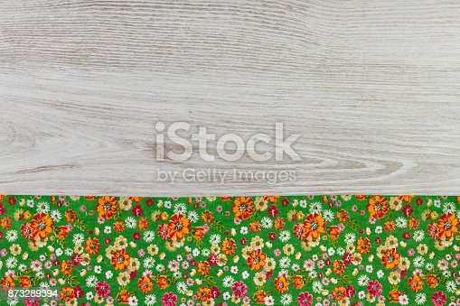 873286578 istock photo Pattern flower cloth napkin on empty wooden background. 873289394