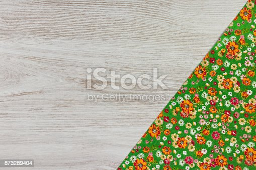 873286578 istock photo Pattern flower cloth napkin on empty wooden background. 873289404