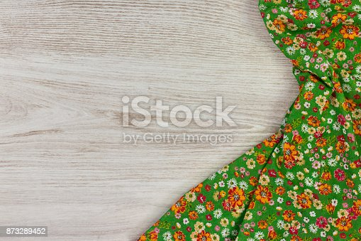 873286578 istock photo Pattern flower cloth napkin on empty wooden background. 873289452