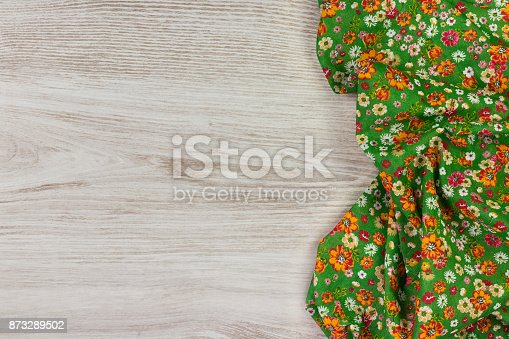 873286578 istock photo Pattern flower cloth napkin on empty wooden background. 873289502