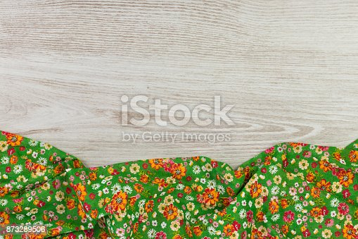 873286578 istock photo Pattern flower cloth napkin on empty wooden background. 873289506