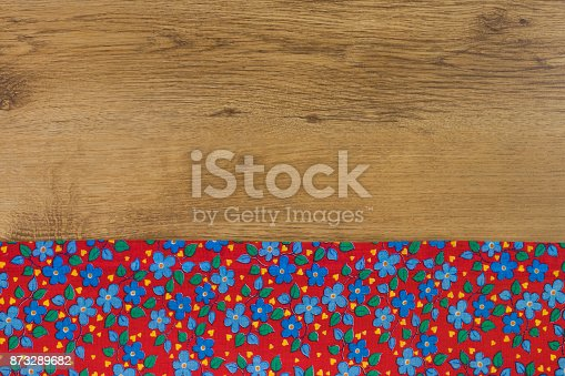 873286578 istock photo Pattern flower cloth napkin on empty wooden background. 873289682