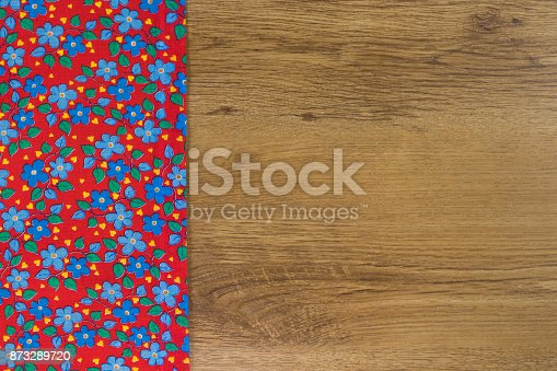 873286578 istock photo Pattern flower cloth napkin on empty wooden background. 873289720