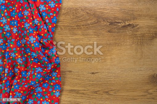 873286578 istock photo Pattern flower cloth napkin on empty wooden background. 873289878