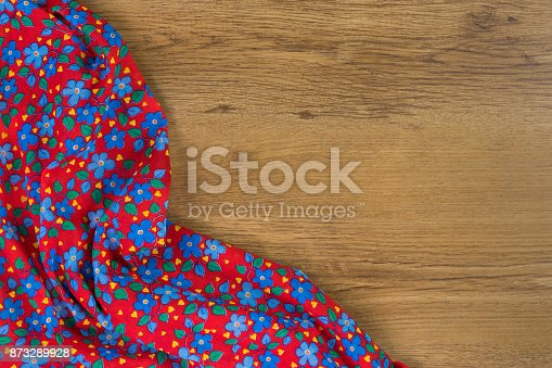 873286578 istock photo Pattern flower cloth napkin on empty wooden background. 873289928