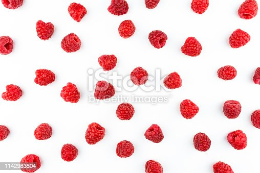 Pattern made from fresh raspberries, top view, flat lay pattern, isolated on a white background.