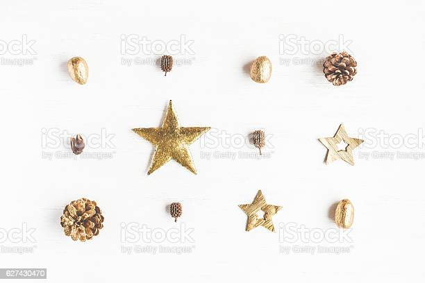 Photo of Pattern made of christmas decoration, pine cones. Flat lay