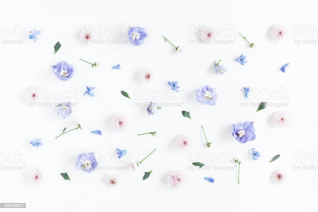 Pattern made of lilac and pink flowers. Flat lay