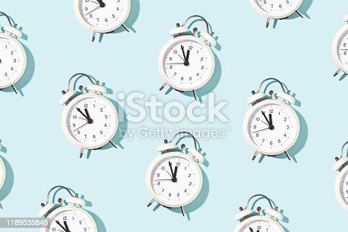 1139289535 istock photo Pattern made of white alarm clocks. 1189535845