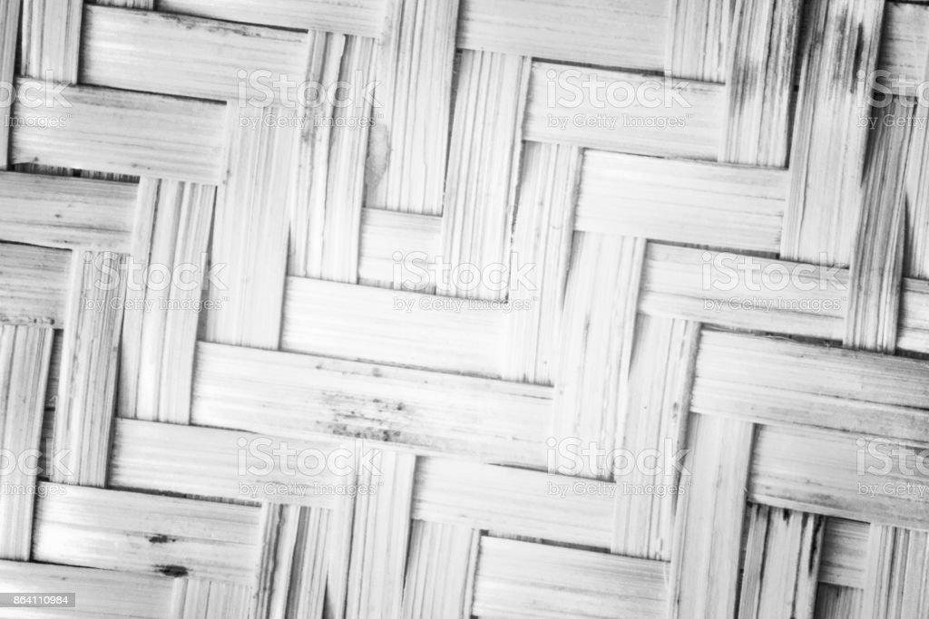 Pattern nature for background of handicraft weave white texture wicker surface. Closeup view. Darker from the centre royalty-free stock photo