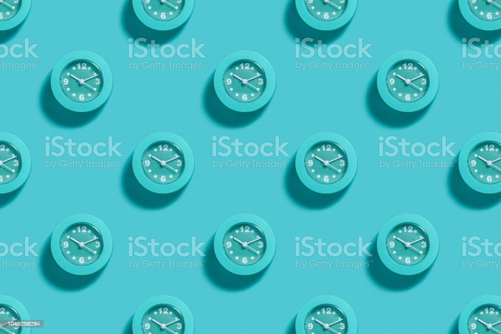 Pattern of blue alarms on light blue background royalty-free stock photo