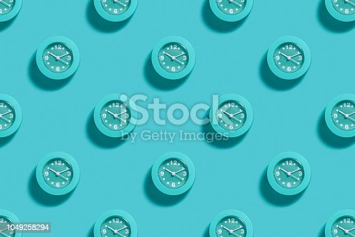 Pattern of blue alarms on pastel blue background. Minimal monochrome concept