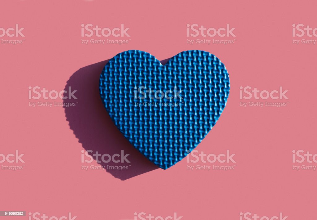 Pattern Of Blue Heart On A Pink Background A Symbol Of Love