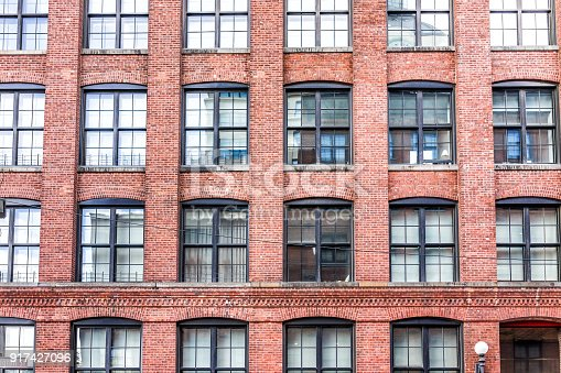 istock Pattern of brick glass window building in Brooklyn, NYC, New York City, front exterior grunge old architecture 917427096